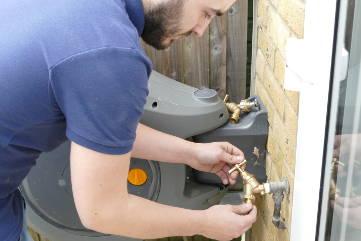 plumber-installing-new-garden-tap