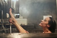 lady-in-bath-with-dark-tiles